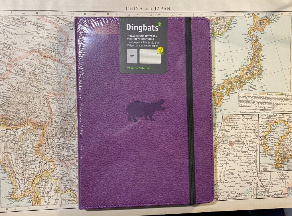 Purple front cover with hippo debossing.