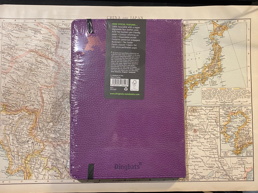 Back cover with a sticker explaining everything there is to know about the notebook.