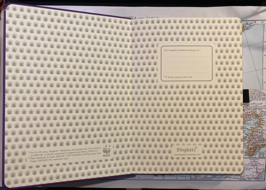 """Front endpaper, with notices on the bottom left, logo on the bottom right, a """"this notebook belongs to"""" box in the middle right and a background of hippo footprints, all printed in warm grey."""